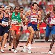 TOKYO, JAPAN August 3:    Milkesa Mengesha of Ethiopia, Grant Fisher of the United States and Paul Chelimo of the United States in action during the Men's 5000m round one heat two race at the Olympic Stadium during the Tokyo 2020 Summer Olympic Games on August 3rd, 2021 in Tokyo, Japan. (Photo by Tim Clayton/Corbis via Getty Images)