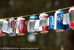 Beer can candleabra made at night in the campground across from the Cabbage Patch during Daytona Beach Bike Week 2015. FL, USA. Wednesday, March 11, 2015.  Photography ©2015 Michael Lichter.