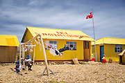 Children play at School on the Floating islands of Lake Titicaka, Puno, Peru, South America