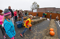 Jax Lien tries his hand at Pumpkin Bowling in the Laconia Savings Bank parking lot in downtown Laconia during Pumpkin Fest on Saturday.  (Karen Bobotas/for the Laconia Daily Sun)