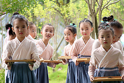 August 26, 2017 - Guizhou, China - Children learn tea arts in an etiquette training institution in Liping County, southwest China's Guizhou Province. During the summer vacation, lots of children attend tea art classes to experience the local tea culture with a long history. (Credit Image: © Yang Daifu/Xinhua via ZUMA Wire)