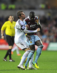 Swansea City's Michu clashes with West Ham United's Mohamed Diame - Photo mandatory by-line: Joe Meredith/JMP - Tel: Mobile: 07966 386802 27/10/2013 - SPORT - FOOTBALL - Liberty Stadium - Swansea - Swansea City v West Ham United - Barclays Premier League