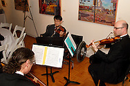 The WSU faculty string quartet provides music for the VIP reception during the 13th Annual ArtsGala at Wright State University's Creative Arts Center, Saturday, March 31, 2012.