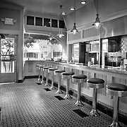 Diner black and white, Commercial architectural photography including retail stores, hotel and country club photography, schools, office interiors, and commercial building daylight and dusk exterior photos.