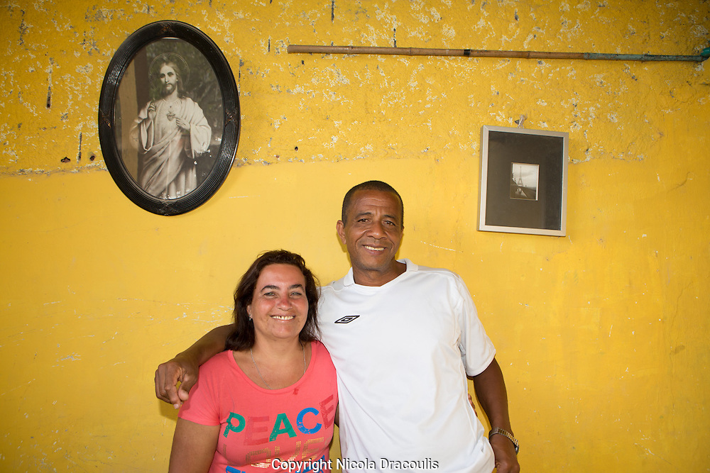 The Rufinos of Babilonia<br /> Vera and Luiz Carlos Rufino in the entrance on their house which they have been running as a B&B for 7 years. Their house overlooks Leme beach and boast views of the entire length of Copacabana.