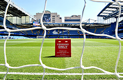 A general view of a sign on the pitch before the Premier League match at Stamford Bridge, London.