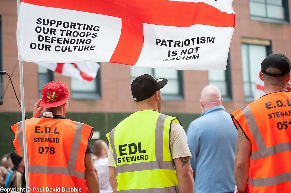 """Rotherham England<br /> 13 September 2014 <br /> EDLStewards outside Main Street Police station where the EDL held a rally as part of the English Defence Leagues """"Justice for the Rotherham 1400"""" March described by an EDL Facebook Page as """"a protest against the Pakistani Muslim grooming gangs"""" on Saturday Afternoon <br /> <br /> <br /> Image © Paul David Drabble <br /> www.pauldaviddrabble.co.uk"""
