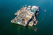 Nederland, Zuid-Holland, Rotterdam, 18-02-2015; Tweede Maasvlakte met Prinses Alexiahaven. In de haven ligt de Pioneering Spirit van offshore bedrijf Allseas (voorheen Pieter Schelte), grootste hefschip ter wereld.<br /> Maasvlakte 2 (MV2), extension of the Port of Rotterdam. The largest crane ship of the world, the Pioneering Spirit, is moored in the Prinses Alexia harbour.<br /> luchtfoto (toeslag op standard tarieven);<br /> aerial photo (additional fee required);<br /> copyright foto/photo Siebe Swart