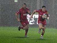 Rugby Union  - 2017 / 2018 European Champions Cup Pool 5. Llanelli Scarlets vs Bath<br /> <br /> Gareth Davies  of Llanelli Scarlets supported by Ken Owens  of Llanelli Scarlets attacks in heavy rain , at Parc Y Scarlets.<br /> <br /> COLORSPORT/WINSTON BYNORTH