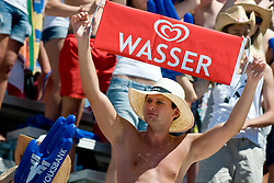 """Fan with sing """"Water"""" at A1 Beach Volleyball Grand Slam tournament of Swatch FIVB World Tour 2010, bronze medal, on August 1, 2010 in Klagenfurt, Austria. (Photo by Matic Klansek Velej / Sportida)"""