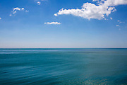 Blue skies and Blue sea, the English Channel on a midsummer day from Folkestone, Kent, England, United Kingdom.