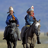 """MONGOLIA, Darhad Valley, Young riders set out for start of a """"naadum"""" (festival) race."""