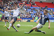 Tommy Spurr (Preston North End) crosses the ball low and hard into the Bolton penalty box during the Pre-Season Friendly match between Bolton Wanderers and Preston North End at the Macron Stadium, Bolton, England on 30 July 2016. Photo by Mark P Doherty.