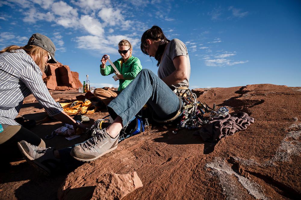 Jewell Lund , Kim Hall and Julia Geisler prepare to cllimb Castleton Tower, Utah.