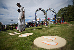 © Licensed to London News Pictures. 21/08/2011. Aldenham, UK. A  Follower of Krishna walks through meditation garden at Bhaktivedanta Manor Temple near Watford today (21/08/2011) to celebrate  the festival of Janmashtami, a celebration of the birth anniversary of Lord Krishna. Janmashtami at Bhaktivedanta Manor is the largest Krishna gathering outside of India with over 60,000 people attending over two days. Bhaktivedanta Manor was donated to the Hare Krishna movement in the early 1970's by former Beatle George Harrison. Photo credit: Ben Cawthra/LNP
