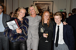 Left to right, JADE YARROW, JANE YARROW, ELLA MEADON and CAMERON YARROW at a private view of photographs by renowned wildlife photographer David Yarrow in aid of TUSK entitled 'Wild Encounters' held at Somerset House on 19th September 2016.