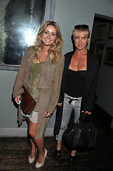 Left to right, SARAH BARRAND and MEG MATHEWS at 'Summer Goes By FAST,' a party celebrating London-based Canadian knitwear designer Mark Fast, held at Paradise, 19 Kilburn Lane, Kensal Green, London on 28th July 2011.