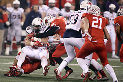 11 December 2015:  Bryce Holm(31) stops Gordon Collins with some help from James Graham(45) NCAA FCS Quarter Final Football Playoff game between Richmond Spiders and Illinois State Redbirds at Hancock Stadium in Normal IL (Photo by Alan Look)