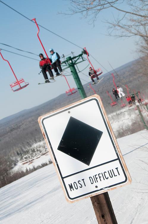 A sign marks runs as difficult Black Diamonds at Indianhead Mountain ski resort near Wakefield Michigan.