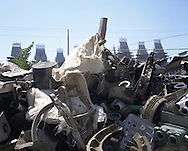 Scrap metal being collected in a garden, prior to being sold to a metal foundry, by the roma (gypsies) of Sintesti, in Romania, early August 2006.  The Kalderari roma of Sintesti are by tradition metal workers, originally making alcohol stills, pots and pans, but now dealing in scrap metal. The large profits from their business have enabled them to build large houses in the village of SIntesti, 20km from Bucharest, and to invest in fast, western brand cars such as BMW's, Mercedes and Porsche.