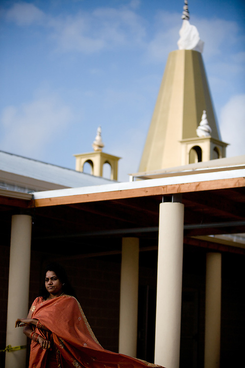 Nalini Rao watches a blessing ritual in front of the new Shirdi Sai Baba Temple in Cedar Park, Texas on Friday March, 19, 2010.