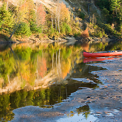 A canoe on the shore of the Merrimack River in Canterbury, New Hampshire.  Fall.
