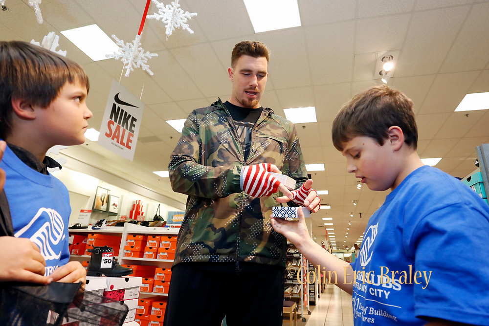 """Corporate Event and Promotional Marketing Photographer in Kansas City - KC Chiefs' Travis Kelce, participates in """"Giving Tuesday"""" helping kids from the Boys & Girls Clubs of Greater Kansas City shop for holiday gifts for their families, at the Bolger's Square JCPenney store in Independence, Mo. Photo by Colin E. Braley for JCPenny"""