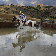 in action at the water jump during the Cross Country event at the Wakatipu One Day Horse Trials at the Pony Club grounds,  Queenstown, Otago, New Zealand. 15th January 2012. Photo Tim Clayton