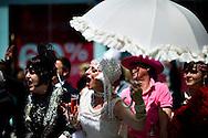 Men dressed in drag cheer, as they attend the annual Gay Pride parade in London, Britain, 29 June 2013. BOGDAN MARAN / BPA
