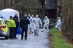 © Licensed to London News Pictures. 21/12/2019. Borehamwood, UK. A Police search team exits a field on Hogg Lane next to a forensic tent after Hertfordshire police were called to the discovery of a man's body on Friday 20th December around 15:38 GMT. London's Metropolitan Police are investigating and are linking the death to the murder of a man found with stab injuries in Scratchwood Park, Barnet in London on 19th December 2019. Photo credit: Peter Manning/LNP