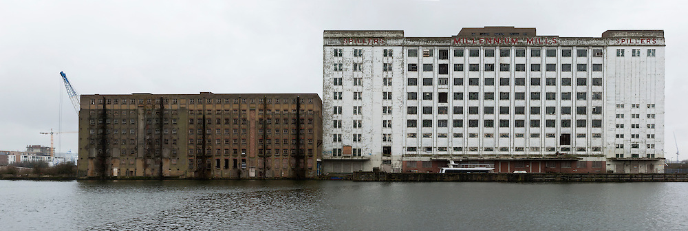 empty wharf buildings with water in front