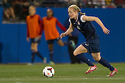 FRISCO, TX - JANUARY 31:  Becky Sauerbrunn #4 of the U.S. Women's National Team controls the ball against the Canadian Women's National Team on January 31, 2014 at Toyota Stadium in Frisco, Texas.  (Photo by Cooper Neill/Getty Images) *** Local Caption *** Becky Sauerbrunn