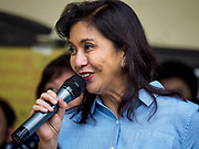 24 JANUARY 2018 - GUINOBATAN, ALBAY, PHILIPPINES: LENI ROBREDO, the Vice President of the Philippines, talks to evacuees at the Barangay Maninila Evacuation Center in Guinobatan East Central School. The Mayon volcano continued to erupt Tuesday night and Wednesday forcing the Albay provincial government to order more evacuations. By Wednesday evening (Philippine time) more than 60,000 people had been evacuated from communities around the volcano to shelters outside of the 8 kilometer danger zone. Additionally, ash falls continued to disrupt life beyond the danger zones. Several airports in the region, including the airport in Legazpi, the busiest airport in the region, are closed indefinitely because of the amount of ash the volcano has thrown into the air.    PHOTO BY JACK KURTZ