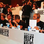 NLD/Hilversum/20100121 - Benefietactie voor het door een aardbeving getroffen Haiti, Mohammed Fouradi en Brahim Fouradi en Peter Blok