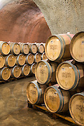 Barrels stored in the wine cave in Chateau Montelena Winery in Napa Valley, California
