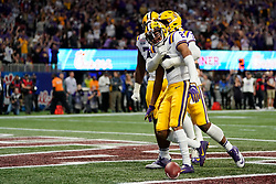 Justin Jefferson #2 of the LSU Tigers celebrates scoring a touchdown during the first half against the Oklahoma Sooners in the 2019 College Football Playoff Semifinal at the Chick-fil-A Peach Bowl on Saturday, Dec. 28, in Atlanta. (Paul Abell via Abell Images for the Chick-fil-A Peach Bowl)