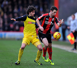 Bournemouth's Marc Pugh battles for the ball with Watford's Diego Fabbrini - Photo mandatory by-line: Alex James/JMP - Tel: Mobile: 07966 386802 18/01/2014 - SPORT - FOOTBALL - Goldsands Stadium - Bournemouth - Bournemouth v Watford - Sky Bet Championship