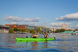 USA, Washington, Seattle. Two women kayaking on Lake Union. MR