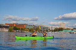 USA, Washington, Seattle. Two women kayaking on Lake Union. MR