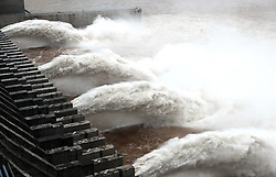 July 5, 2018 - Yichang, Hubei, China - Water discharging from the Three Gorges Dam, a gigantic hydropower project on the Yangtze River, in central China's Hubei Province. At 8 a.m. of July 5, the reservoir faced an inflow of 51,000 cubic meters per second and an outflow of 40,000 cubic meters per second. The first flood of the Yangtze River this year has formed on its upper reaches. (Credit Image: © Wang Shen/Xinhua via ZUMA Wire)