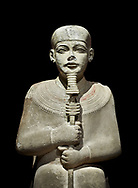 """Ancient Egyptian statue of Ptah - limestone - New Kingdom. 18th Dynasty, reign of Amenhotep III (1390 - 1353 BC), Karnac. Egyptian Museum, Turin.  black background<br /> <br /> Large statue of Egyptian gods are rare and most of them are part of building designs. This imposing statue of Ptah was probably made for the """"Temple of Millions of Years"""", on the west bank of Thebes, promoted by Amenhotep III . When the temple was eventually abandoned its statues were reused in other temples in the region. Drovetti collection C. 87 .<br /> <br /> If you prefer to buy from our ALAMY PHOTO LIBRARY  Collection visit : https://www.alamy.com/portfolio/paul-williams-funkystock/ancient-egyptian-art-artefacts.html  . Type -   Turin   - into the LOWER SEARCH WITHIN GALLERY box. Refine search by adding background colour, subject etc<br /> <br /> Visit our ANCIENT WORLD PHOTO COLLECTIONS for more photos to download or buy as wall art prints https://funkystock.photoshelter.com/gallery-collection/Ancient-World-Art-Antiquities-Historic-Sites-Pictures-Images-of/C00006u26yqSkDOM"""