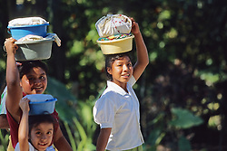 Woman & Children Carrying Things On Head