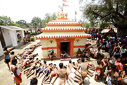 April 13, 2017 - Bhubaneswar, Orissa, India - Villagers roll in the hot sand on their village road and around their deities temple to celebrate the Mahavisubha Sankranti ( locally observed it as the new year) at a village outskirts of the eastern Indian state Odisha on 14 April 2017. Villagers take penance themselves for the betterment for upcoming year and also Goodwill of the Universe. (Credit Image: © Str/NurPhoto via ZUMA Press)