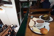 """In the historic very popular """"La puerta falsa,"""" cup of hot chocolate with cheese, bread and tamal"""