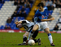 Photo: Leigh Quinnell.<br /> Birmingham City v Newcastle United. The FA Cup. 06/01/2007. Birminghams Mat Sadler tangles with Newcastles James Milner.