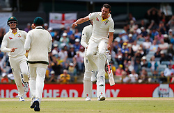 Australia's Josh Hazelwood celebrates the wicket of England's Craig Overton during day five of the Ashes Test match at the WACA Ground, Perth.