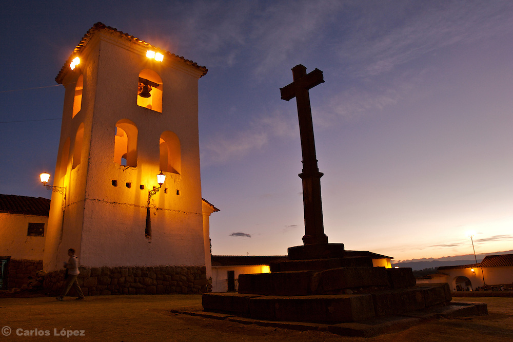 THE  CHURCH IN CHINCHEROS  A SMALL TOWN NEAR TO CUSCO  IN THE PERUVIAN ANDES IN  PERU WITH A CROSS IN FRONT OF IT.