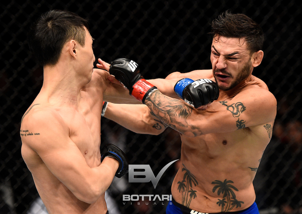TORONTO, CANADA - DECEMBER 10:  (L-R) Dooho Choi of South Korea and Cub Swanson trade punches in their featherweight bout during the UFC 206 event inside the Air Canada Centre on December 10, 2016 in Toronto, Ontario, Canada. (Photo by Jeff Bottari/Zuffa LLC/Zuffa LLC via Getty Images)