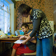 CAPTION: Dmitry's autism is clearly extreme, and his mother Ksenya spends a great deal of time researching his condition, trying to find ways to help him. She has taken great heart from her recent success in getting him to learn the alphabet and point to the letters she's saying. LOCATION: St Petersburg, Russia. INDIVIDUAL(S) PHOTOGRAPHED: Ksenya Shpunt (mother) and Dmitry Shpunt (son).