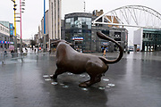 National coronavirus lockdown three begins at the Bull Ring Shopping Centre in Birmingham city centre, which is deserted apart from a few people passing the Bully sculpture on 6th January 2021 in Birmingham, United Kingdom. Following the recent surge in cases including the new variant of Covid-19, this nationwide lockdown, which is an effective Tier Five, came into operation today, with all citizens to follow the message to stay at home, protect the NHS and save lives.